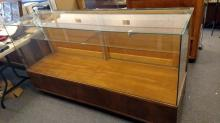 6' Glass top Display Case, single glass shelf, wooden back sliding door, pick up item only