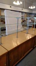 Display unit with two glass shelves, storave underneath with shelf and sliding wood doors, Pick up item only.