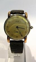 PIAGET. Montre. (long. 20 cm, diam. 33 mm).