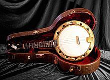 Banjo ayant appartenu à George Harrison.      Banjo ayant précédemment appartenu à Georg