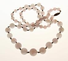 A Chinese Qing Carved Rose Quartz Necklace