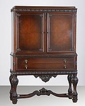 Early 20th c. carved black walnut cabinet