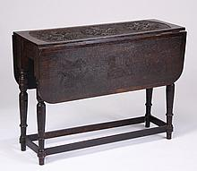 19th c. English carved oak drop leaf table