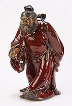 Asian ceramic sculpture of a warrior, 19