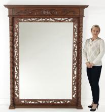 Oversized Italian carved walnut mirror, 78