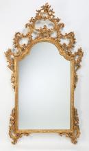 Italian carved gilt wood mirror, 54