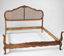 French carved walnut bed with woven cane headboard
