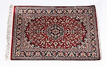Handwoven silk Persian rug, signed