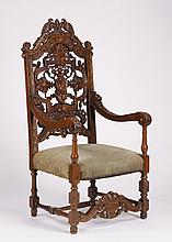 19th c. French carved oak armchair, 57