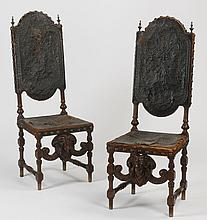 (2) Carved oak side chairs in leather, 19th c