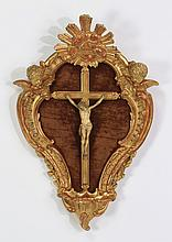 Continental gilded crucifix in carved frame