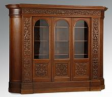 Early 20th c. carved oak demilune cabinet