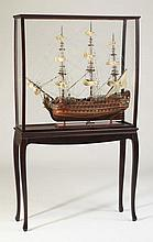 Carved mahogany model ship on stand