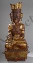 Buddha Maravijaya paré assis en virasana sur un  socle quadrangulaire, la main droite en bhumisparsha mûdra. Il est coiffé d'une couronne de plumes. Bois laqué et doré. Birmanie. Royaume des Etats Shan. 19ème siècle. Ht 77cm