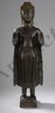 Buddha debout en abhaya mudra vêtu d'une robe monastique Utarasanga et coiffé de fines bouclettes sommé d'un l'Ushnisha. Bronze à patine brune. Laos. Royaume de Luang Prabang. 17ème. Ht 59 cm