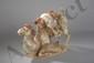 Chameau, agenouillé sur une terrasse, bâté et chargé de ballots. Terre cuite à engobe et traces de polychromie. Chine. Dynastie Tang. 618 à 907.