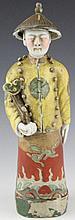 Figuration d'un dignitaire en biscuit à couverte d'émaux polychromes de la famille rose , vêtu d'une tenue impériale et portant un sceptre Ruy . Chine Dynastie Qing  . 31cm