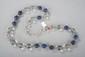 Collier recomposé selon la tradition de perles de cristal de roche et de lapis lazuli séparées par de perles granulées de métal argenté. Afghanistan.