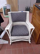 White Wicker Rocker with Cushion.