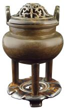 Tri - legged bronze cener with a floral inspired base and detachable lid