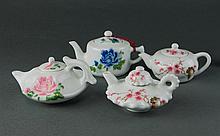 Huai Ren Tang.A Group Of Four Under Glaze Famille Floral Tea Pots