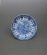 Qing. A Blue And White 'Flower' Dish
