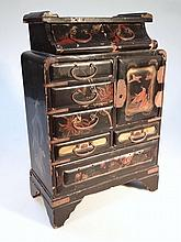 A Japanese lacquered jewellery cabinet, with two