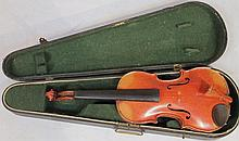 A pine violin, with a polished two piece back and