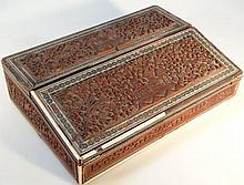 A 19thC Indian hardwood writing slope, the heavil
