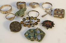 Various artifacts, to include a bronze buckle, a