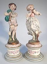 A pair of 19thC Continental bisque figures, of ch