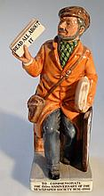 A Royal Doulton figure, The News Vendor HN2891, l