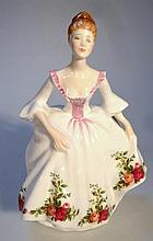 A Royal Doulton figure, Country Rose HN3221, prin