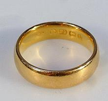 A 22ct gold circular wedding band, 7.8g.