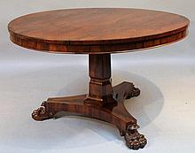 A William IV rosewood snap top supper table, the