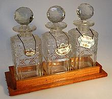 A three bottle decanter, each cut glass bottle wi