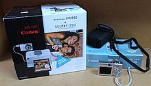 A Canon Ixus digital 50 camera, and a Selphy CP51