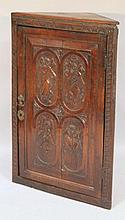 An 18thC oak hanging corner cupboard, the hinged