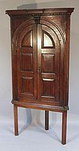 An 18thC oak corner cupboard, with an inverted fi