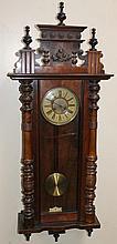 A 19thC walnut cased Vienna wall clock, the circu