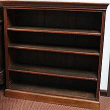 A Victorian oak open bookcase, with an upper fixe