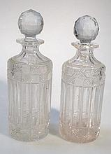 A pair of Edwardian glass decanters, with orb sto
