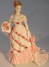 A Royal Worcester figure, A Celebration At Winter