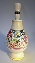A Poole lamp, decorated with birds and flowers in