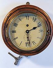 An early 20thC bulk head clock, the brass mounted