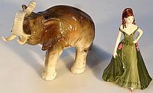 A Royal Dux figure, of an elephant with trunk rai