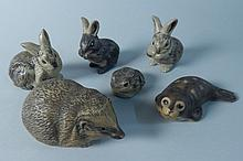 Six Poole Pottery animal ornaments, a seal, frog