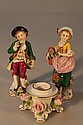 Two 20thC porcelain figures of a girl and boy and