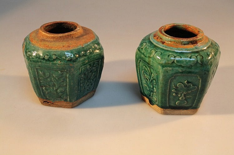 A pair of Chinese celadon glazed hexagonal ginger