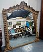 A Victorian gilt over mantel mirror, in the rococo